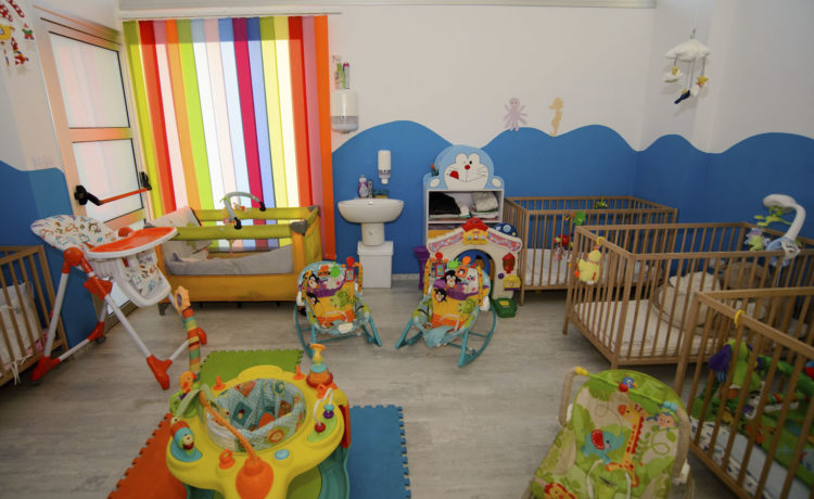 The infants enjoy a bright and happy classroom, full of toys right for their age group.